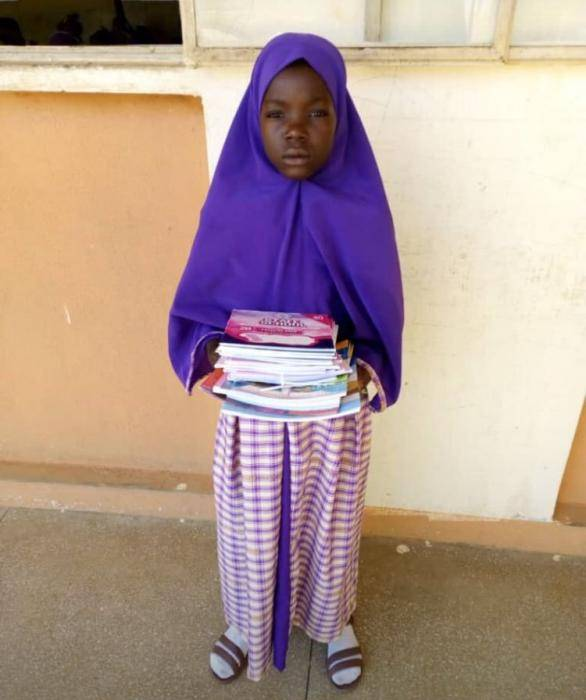 Update: Groundnut Seller Who Signed on a Graduating Student's Shirt Enrolled in School