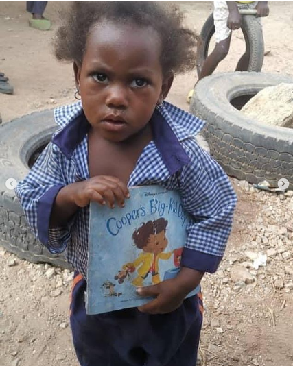 A toddler who habitually loitered around school gets enrolled as a pupil