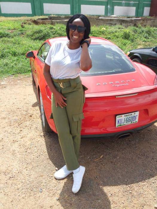 Viral Photo of Female Corper Who Stepped Out With a Porsche For Clearance in Abuja